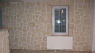 Comment poser les pierres de parement sur le mur